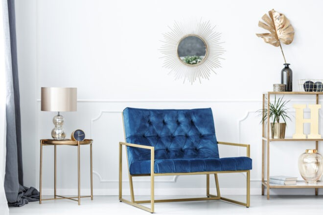 blue accent chair in a neutral living room design