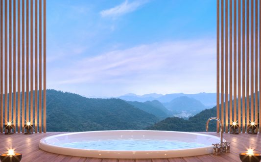 bathroom with a view of the surrounding mountains